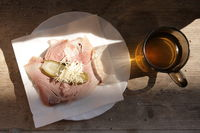 Typical tyrolean snack meal. Ham sandwich with apple cider or must. Originally called Brettljause with Most or Sturm.