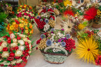 Baskets with colorful flowery decorations for sale