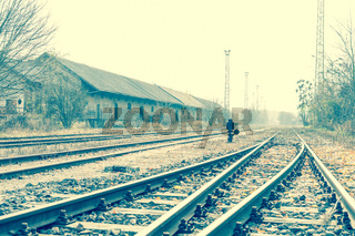 Photo of abandoned rails and a railway station