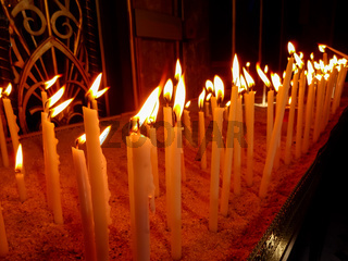 Candles in a church. Group of burning candles.
