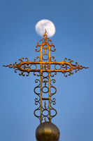 Cross in front of the moon