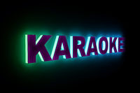 word KARAOKE with neon light