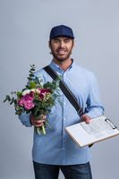 Delivery man bringing flower bouquet