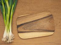 Organic spring onions on wood