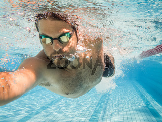 Pro male swimmer in the swimming lane