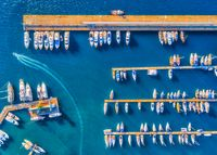 Aerial view of beautiful boats at sunset in summer