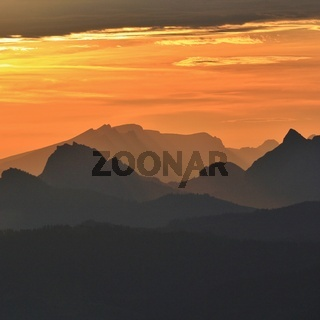 Golden sunrise in the Swiss Alps. View from Mount Rigi.