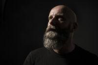 a dark male portrait in classic rembrandt light