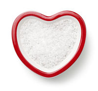 Salt In Heart Shaped Bowl Isolated On White Background