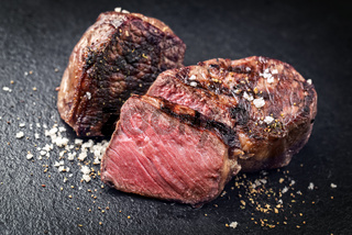 Barbecue wagyu roast beef sliced as top view on a black board