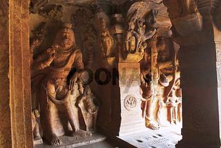 Cave 3 : Carved figure of Vishnu as Narasimha, half human, half lion, on the left and Trivikrama on the right. Badami Caves, Karnataka, India.