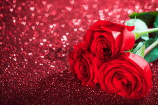Red rose flowers and glitter hearts