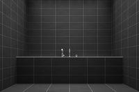 a bathroom with black tiles
