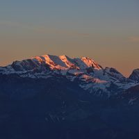 Snow capped mountain Blüemlisalp at sunrise. View from Mount Niederhorn. Bernese Oberland, Switzerland.