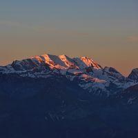 Snow capped mountain Blüemlisalp at sunrise. View from Mount Niederhorn. Bernese Oberland, Switzerland.