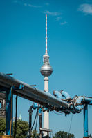 TV Tower / Television tower behind blue water pipes in Berlin  - construction site