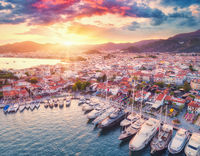 Aerial view of boats and yachts and beautiful city at sunset