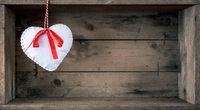 felt heart on a wooden background