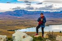 Woman photographer on the mountain