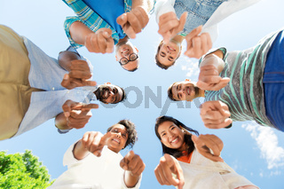 happy friends pointing at you standing in circle