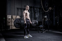 Muscular Man Doing Heavy Deadlift Exercise.