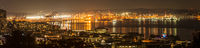 Panoramic night views of Seattle's Elliott Bay and the harbor.