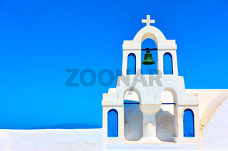 Small white bell-tower in Santorini