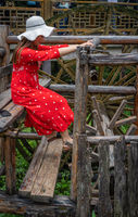 Woman working on the old Water wheel