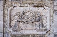 Old plaque depicting angels