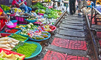 Selling food on the Maeklong Railway market in Thailand.