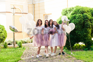 Happy lovely girlfriends at hen party in the summer outdoors