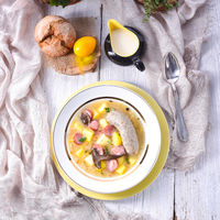 a polish easter soup with homemade white sausage and mushrooms
