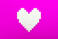 Heart of sugar cubes, pink background