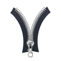 Metallic fastener, open zipper on white
