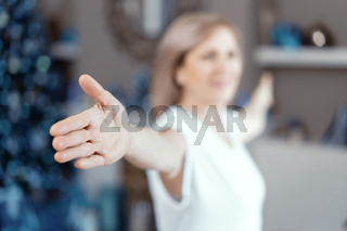 Mature woman is stretching arms. Selective shot