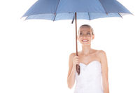 Bride woman in white wedding dress with umbrella.