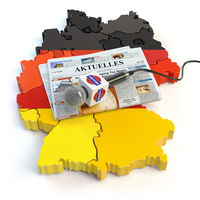 German news, press and  journalism concept. Microphone and newspaper with headline