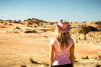 Female tourist visitor looking out to the Mungo Lunettes