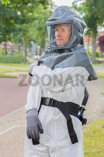 Insect fighter wears airtight work suit