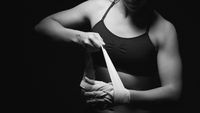 Woman preparing her hands for the fight.