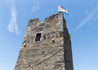 Flag at tower medieval ruin of Brandenbourg in Luxembourg