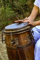 Woman hands playing drum