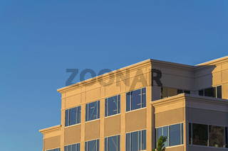 Exterior view of a modern building against clear blue sky on a sunny day