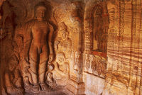 Cave 4 : Carved figure of Bahubali with his lower legs surrounded by snakes, together with his daughters Brahmi and Sundari