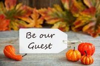 Label With Text Be Our Guest, Pumpkin And Leaves