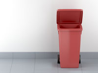 Red plastic waste container