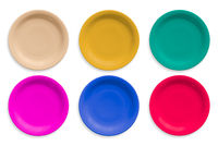 Colored ceramic round plates isolated on white background