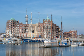 Dutch Harbor of Lelystad with communication Tower and apartment building