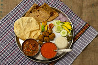 Authentic Maharashtrian lunch thali with Amras and poli, India.