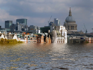 manipulated conceptual image of the city of london flooded due to global warming and rising sea levels